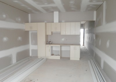 Semi detached dwelling, walls lined and flushed – Kitchen cabinetry