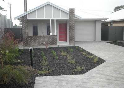 Single storey residential home with garden landscape