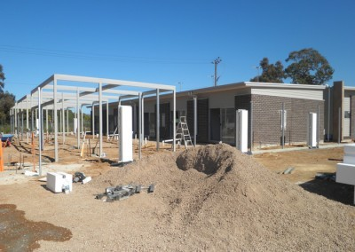 Carports under construction – Southern view of single storey residential units